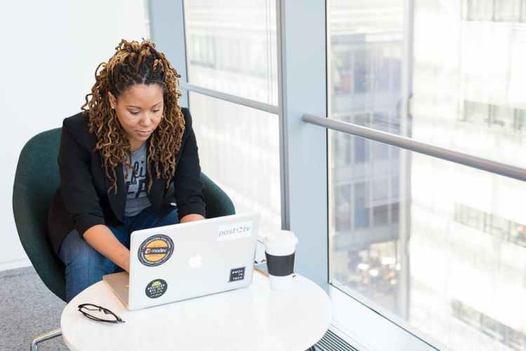 a black lady writing her business plan