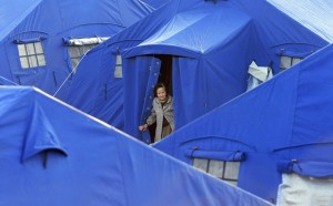 A woman is seen in a tent camp in L'Aquila April 7, 2009. (©REUTERS/Alessandro Bianchi)
