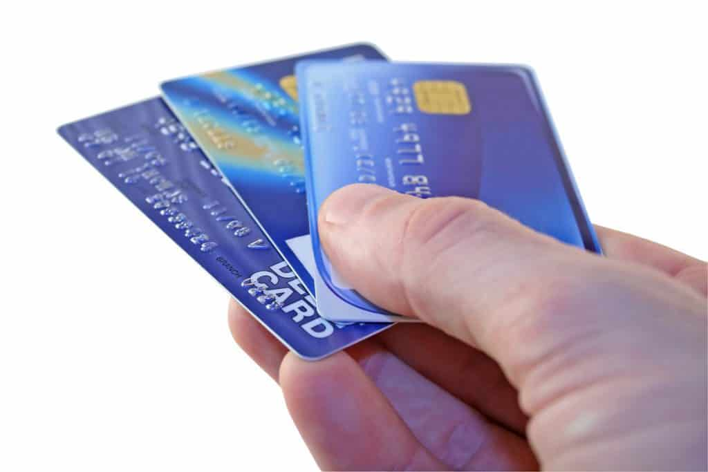 Man hands over credit cards for payment
