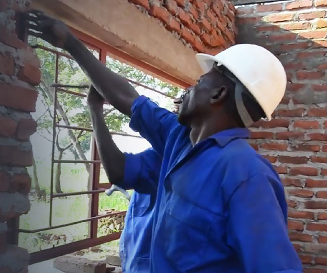 men working on a building