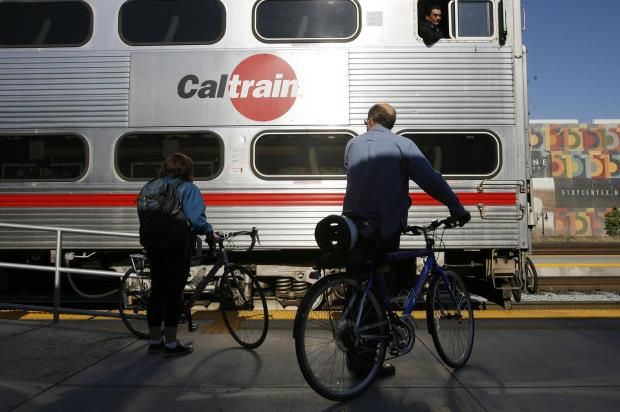 Bicycle commuters prepare to board at Diridon Station last week; a Caltrain survey says one in 15 riders wants to bring a bike on board.
