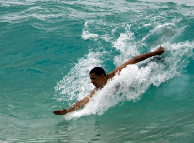 Barack Obama swimming in Hawaii in 2008. (AP Photo/Alex Brandon, File)
