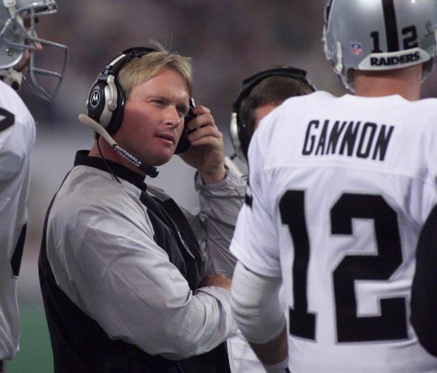 PHOTO BY KAREN T. BORCHERS RAIDERS Head coach Jon Gruden, talks with Raiders Quarterback #12 Rich Gannon, during a break.