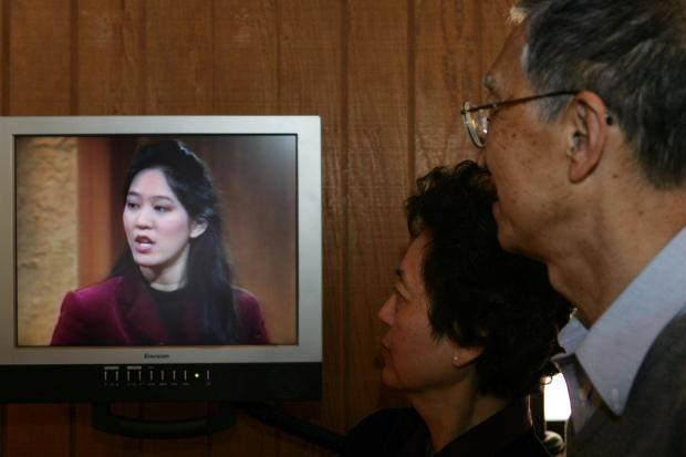 "As part of an exhibit at Stanford's Hoover Institution in 2009, a video played continuously of an interview Iris Chang gave to a Canadian TV reporter. Chang's parents, Ying-Ying and Shau-Jin Chang, watched as they toured the exhibit, titled ""Shattered Peace: The Road to World War II."""