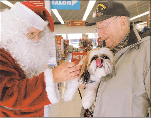 Walnut Creek resident Hirsh Morton and his dog, Toshi, visit with Santa Claus recently at Pet Food Express in Walnut Creek.