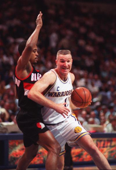 The Warriors' Chris Mullin drives past the Blazers' Rod Strickland in this April 15, 1994 file photo.