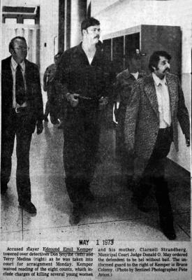 Edmund Emil Kemper towered over detectives Dom Smythe, left, and Terry Medina, right, as he was taken into court for arraignment in April 1973. Kemper was conflicted of killing eight women from 1964 to 1973, including his mother, Clarnell Strandberg.