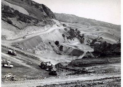 Mercury News archives - Anderson Reservoir Dam as it appeared when it was still under construction in 1950. The area shown in the background would eventually be submerged by more than 200 feet of water.