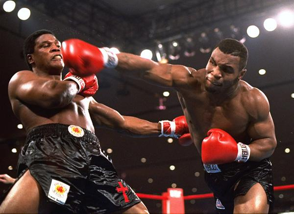 Mike Tyson, right, delivers a powerful blow to Trevor Berbick in the second round Nov. 22, 1986, in Las Vegas. Tyson became the youngest heavyweight champion shortly after with a TKO.