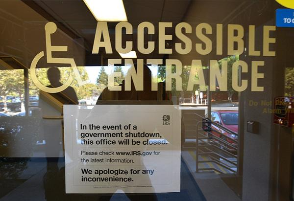 A sign on the door of the Internal Revenue Office tells people the office is closed during the federal government shutdown in Walnut Creek on Oct. 1, 2013.