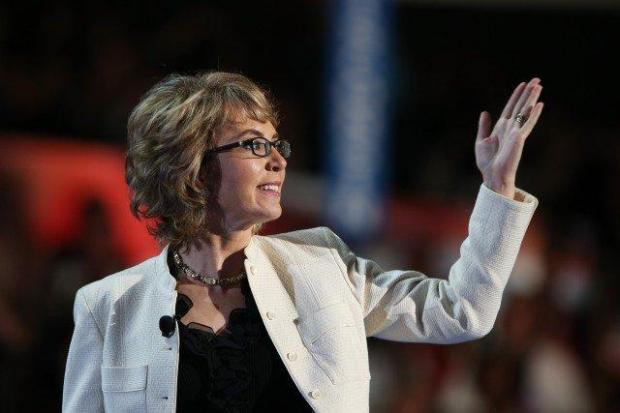 Former U.S. Rep. Gabrielle Giffords walks on stage during the Democratic National Convention on Sept. 6, 2012 in Charlotte, N.C.