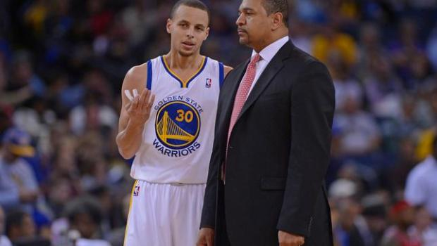 Golden State Warriors' Stephen Curry (30) chats with head coach Mark Jackson during a time out in the first quarter of their game at Oracle Arena in Oakland, Calif., on Sunday, Jan. 26, 2014. (Jose Carlos Fajardo/Bay Area News Group)