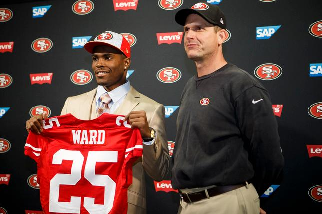Jimmie Ward of Northern Illinois University left who was drafted by San Francisco 49ers stands with head coach Jim Harbaugh during a press conference