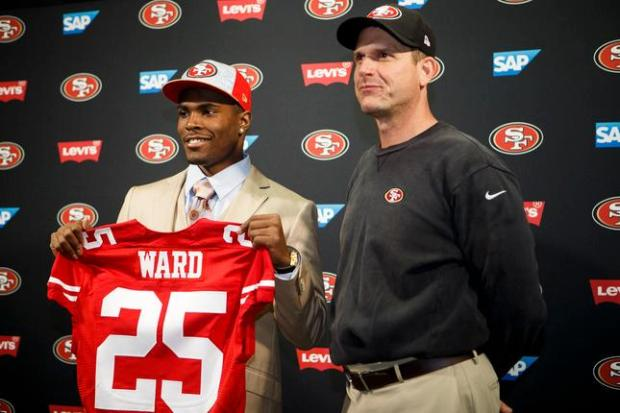 Jimmie Ward of Northern Illinois University, left, who was drafted by San Francisco 49ers, stands with head coach, Jim Harbaugh, during a press conference on May 9, 2014 at 49ers' Santa Clara training facility. (Dai Sugano/Bay Area News Group)