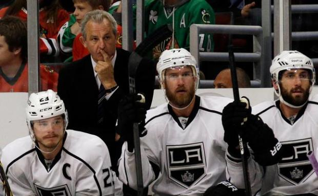 Los Angeles Kings head coach Darryl Sutter watches during the first period in Game 7 of the Western Conference finals in the NHL hockey Stanley Cup playoffs against the Chicago Blackhawks Sunday, June 1, 2014, in Chicago. (AP Photo/Nam Y. Huh)