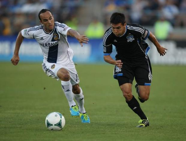 San Jose Earthquakes' Shea Salinas and LA Galaxy's Landon Donovan race toward the ball in the first half at Stanford Stadium in Stanford on Saturday, June 29, 2013. (Jim Gensheimer/Bay Area News Group)