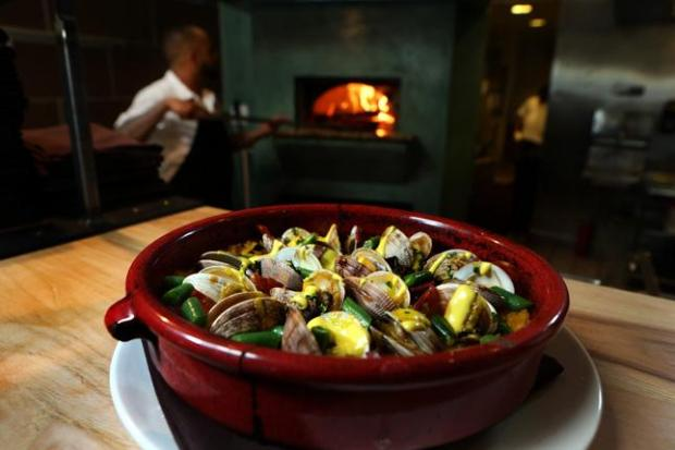 Manila clams and chorizo known as bomba is one of the main dishes served at the new restaurant Shakewell in Oakland, Calif., on Tuesday, Aug. 12, 2014. (Ray Chavez/Bay Area News Group)