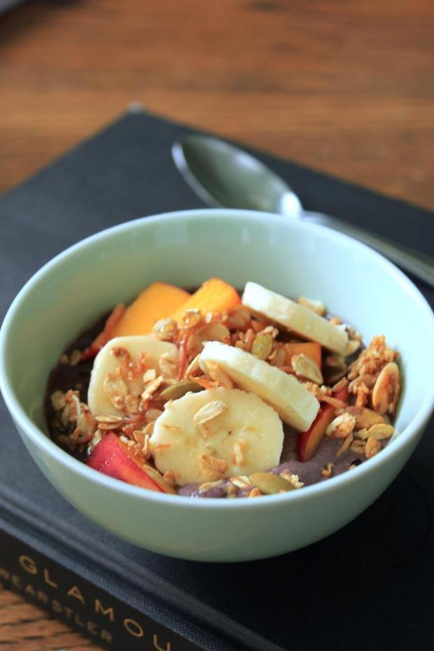 Acai berry bowls, topped with granola, bananas and other seasonal fruit, are a classic breakfast in Brazil.