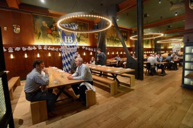 The communal tables of the beer hall and the back dining room photographed at Schroeder's restaurant in San Francisco, Calif., on Wednesday, Oct. 1, 2014. The century old German beer hall in the Financial District still has all its Bavarian charm, but has been updated to be fresh and current. The areas can be separated by a curtain. (Dan Honda/Bay Area News Group)