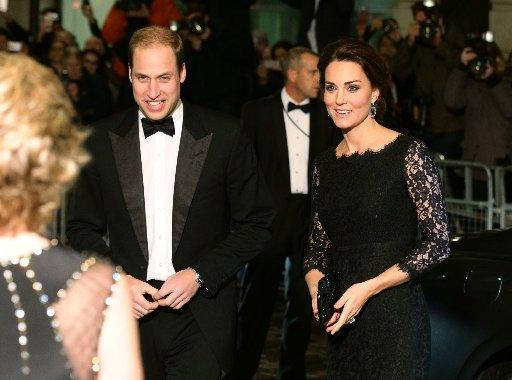 Britain's Catherine, Duchess of Cambridge, and Prince William, The Duke of Cambridge arrive to attend the Royal Variety Performance at the London Palladium Theatre on November 13, 2014.