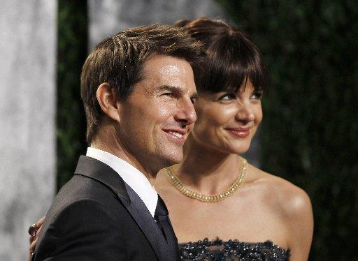 Tom Cruise and Katie Holmes arrive at the 2012 Vanity Fair Oscar party in West Hollywood, California in this February 26, 2012 file photo
