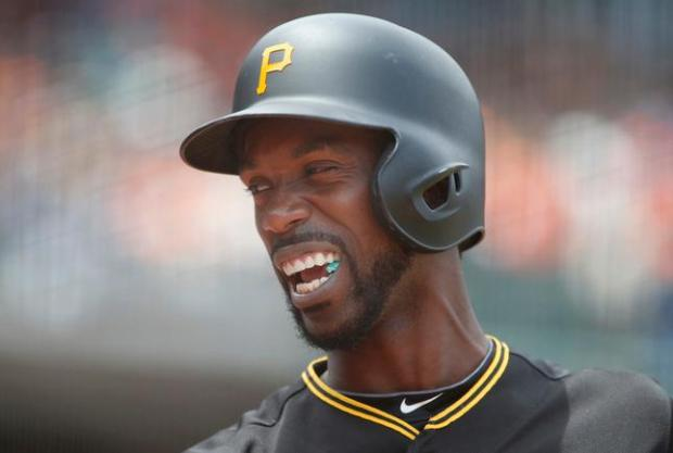 Andrew McCutchen of the Pittsburgh Pirates jaws with a fan at AT&T Park in San Francisco, Calif. during the San Francisco Giants game Wednesday afternoon, June 3, 2015, (Karl Mondon/Bay Area News Group)