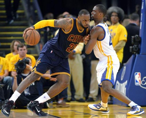 Cleveland Cavaliers' LeBron James (23), left, tries to push past Golden State Warriors' Harrison Barnes (40) in the second quarter of Game 2 of the NBA Finals at Oracle Arena in Oakland, Calif., on Sunday, June 7, 2015. (Doug Duran/Bay Area News Group)