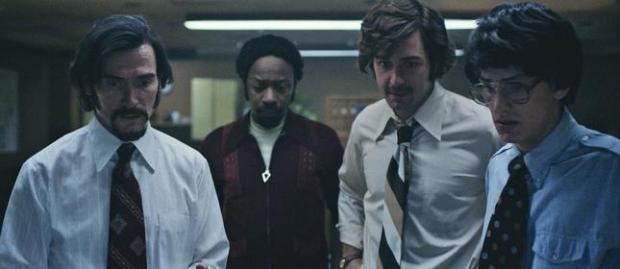 Billy Crudup as Dr. Philip Zimbardo, Nelsan Ellis as Jesse Fletcher, James Wolk as Mike Penny and Matt Bennett as Kyle Parker in 'The Stanford Prison Experiment.' (Steve Dietls/IFC)