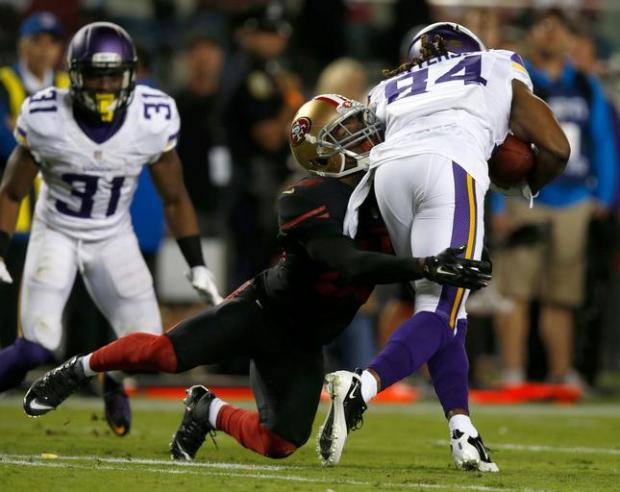 San Francisco 49ers' Jimmie Ward (25) tackles Minnesota Vikings' Cordarrelle Patterson (84) in the third quarter of their NFL game at Levi's Stadium in Santa Clara, Calif., on Monday, Sept. 14, 2015. (Nhat V. Meyer/Bay Area News Group)
