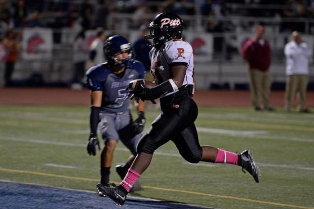Pittsburg's Montaz Thompson (21) scores a touchdown past Freedom's Ryan Mucher (3) in the second quarter of their game at Freedom High School in Oakley, Calif., on Friday, Oct. 9, 2015. (Jose Carlos Fajardo/Bay Area News Group)