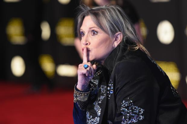 "HOLLYWOOD, CA - DECEMBER 14: Actress Carrie Fisher attends Premiere of Walt Disney Pictures and Lucasfilm's ""Star Wars: The Force Awakens"" on December 14, 2015 in Hollywood, California. (Photo by Jason Merritt/Getty Images)"