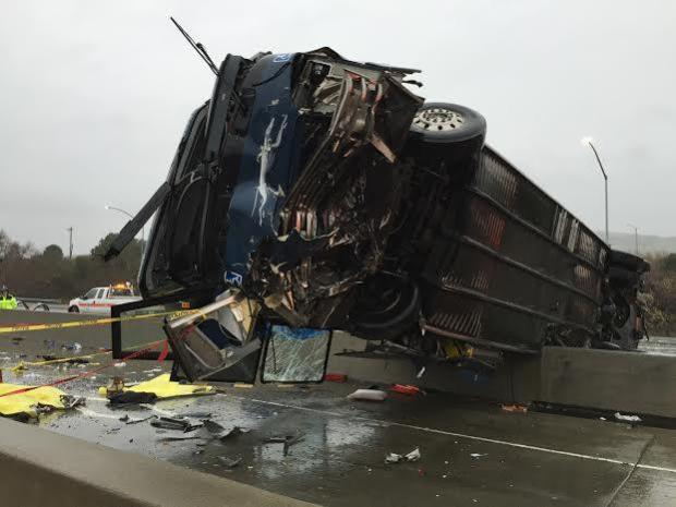 The wreckage of a Greyhound bus straddles the divider of Highway 101 near Highway 85 in South San Jose, Calif., on Tuesday, Jan. 19, 2016. (Gary Reyes/Bay Area News Group)