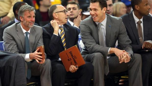 Golden State Warriors coaching staff Bruce Faiser, left, Ron Adams, interim head coach Luke Walton and Jarron Collins share a moment in the first half of an NBA game against the Phoenix Suns at Oracle Arena in Oakland, Calif., on Wednesday, Dec. 16, 2015. (Ray Chavez/Bay Area News Group)