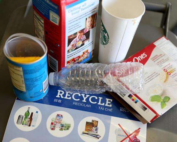 Paper cups, cartons, frozen food boxes, chip containers and hard plastics go in the recycling bin and are photographed at Waste Management's Davis Street Transfer Station, in San Leandro, Calif., on Wednesday, March 2, 2016. (Anda Chu/Bay Area News Group)
