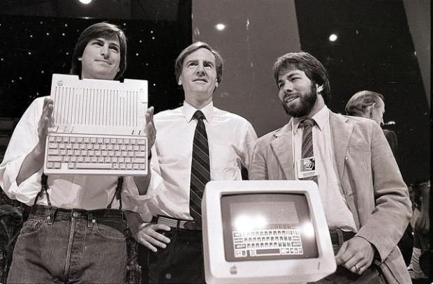 Steve Jobs, left, chairman of Apple Computers, John Sculley, center, president and CEO, and Steve Wozniak, co-founder of Apple, unveil the new Apple IIc computer in San Francisco, April 24, 1984. (AP Photo/Sal Veder)