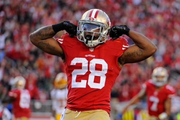 San Francisco 49ers' Carlos Hyde (28) celebrates after scoring a four-yard touchdown against Washington in the fourth quarter of their NFL game at Levi's Stadium in Santa Clara, Calif., on Sunday, Nov. 23, 2014. San Francisco defeated Washington, 17-13. (Jose Carlos Fajardo/Bay Area News Group)