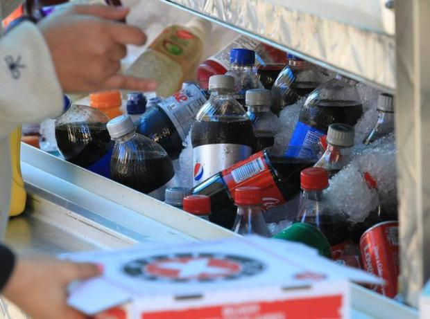Students choose from an array of sodas and fruit juices at a food truck on Milvia Way during their lunch hour in Berkeley, Calif., on Tuesday, Nov. 10, 2015. A year ago, Berkeley passed a tax on sugar-sweetened sodas and other drinks. (Laura A. Oda/Bay Area News Group)