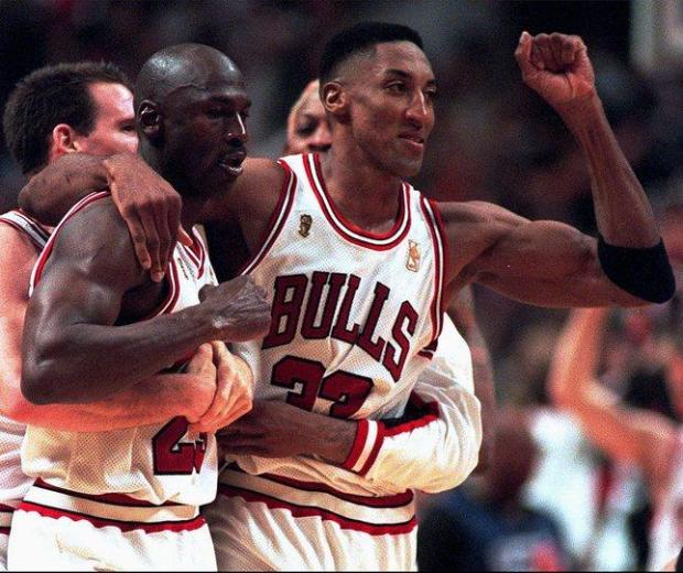Chicago Bull's Michael Jordan celebrates a last-second game win with teammate Scottie Pippen, right, Jud Buechler, left - and Dennis Rodman, behind. (1965)