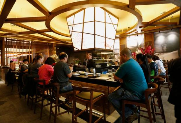 The bar and main dining room is packed with patrons during the grand opening of the world-famous Din Tai Fung dumpling palace at Westfield Valley Fair mall in Santa Clara, Calif., on Tuesday, May 10, 2016. (Gary Reyes/Bay Area News Group)