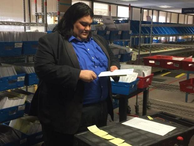Santa Clara County assistant registrar Matt Moreles opens a single ballot to be counted in the District 4 San Jose City Council race on Monday, July 25, 2016. Councilman Manh Nguyen trails challenger Lan Diep by 12 votes, and is paying for a recount.
