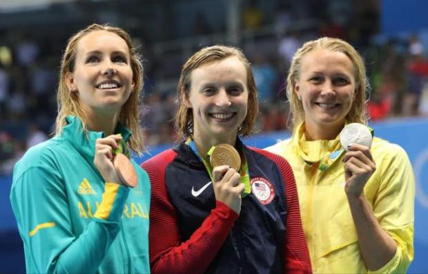 Winner United States' Katie Ledecky, center, second placed Sweden's Sarah Sjostrom, right, and third placed Australia's Emma McKeon hold their medals after the women's 200-meter freestyle during the swimming competitions at the 2016 Summer Olympics, Tuesday, Aug. 9, 2016, in Rio de Janeiro, Brazil. (AP Photo/Lee Jin-man)