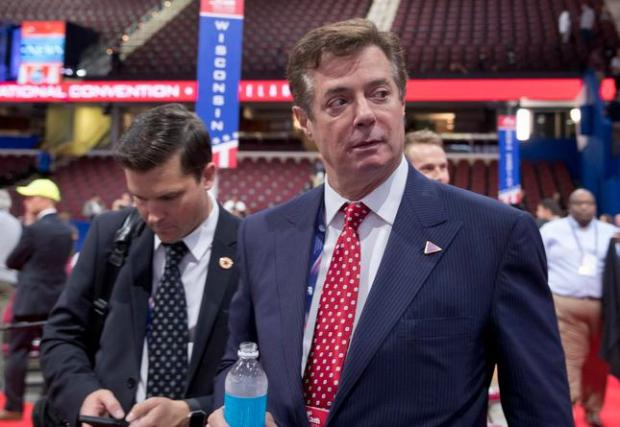 FILE - In this July 18, 2016, file photo, Trump campaign chairman Paul Manafort walks around the convention floor before the opening session of the Republican National Convention in Cleveland. Manafort resigned in wake of campaign shakeup and revelations about Ukraine work. (AP Photo/Carolyn Kaster, File)