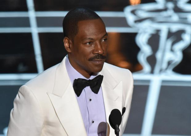 In this Feb. 22, 2015 file photo, Eddie Murphy presents the award for best original screenplay at the Oscars at the Dolby Theatre in Los Angeles.