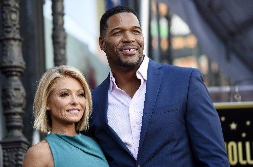 In this Oct. 12, 2015 photo, Kelly Ripa poses with Michael Strahan during a ceremony honoring Ripa with a star on the Hollywood Walk of Fame in Los Angeles.