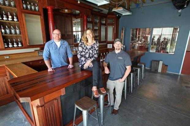 Sutherland Distilling is opening a new tasting room, thanks to new California legislation. Among those celebrating are Ryan Sutherland, co-owner and distiller, center, Eric Larimar, co-owner and assistant distiller, right, and Tina Peterson, distillery manager. (Laura A. Oda/Bay Area News Group)