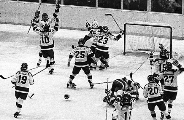 """FILE - In this Feb. 22, 1980, file photo, The United States ice hockey team rushes toward goalie Jim Craig after their 4-3 upset win over the Soviet Union in the semi-final round of the XIII Winter Olympic Games in Lake Placid, N.Y., The American players from left are, Mark Johnson (10); Eric Strobel (19); William Schneider (25); David Christian (23); Mark Wells (15); Steve Cristoff (11); Bob Suter (20), Philip Verchota (27). John O'Callahan is hugged by Michael Ramsey. Although Mark Johnson is sitting on the mother of all hockey motivational stories, he's waiting until just the right moment to break it out for the U.S. women's team. Johnson was the reason for the """"Miracle on Ice"""" 30 years ago, scoring two goals for the U.S. hockey team when they toppled the Soviets. (AP Photo/File)"""