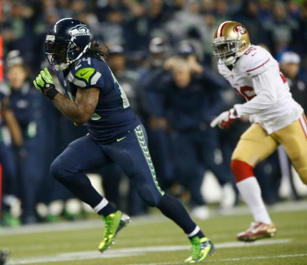 San Francisco 49ers' Tramaine Brock (26) chases Seattle Seahawks Marshawn Lynch (24), who scores touch-down during the third quarter of the NFC Championship Game at CenturyLink Field in Seattle, Wash., on Sunday, Jan. 19, 2014. (Josie Lepe/Bay Area News Group)