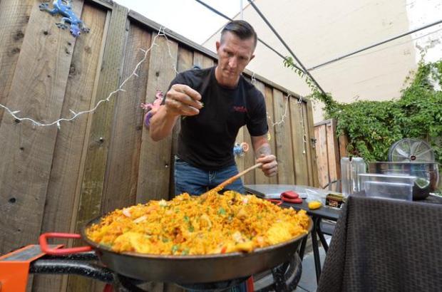 Gianni Schell, owner of the Pura Vida Cocina Latina & Sangria Bar, makes chicken, shrimp and chorizo paella in downtown Livermore, Calif., on Thursday, Aug. 11, 2016. (Doug Duran/Bay Area News Group)