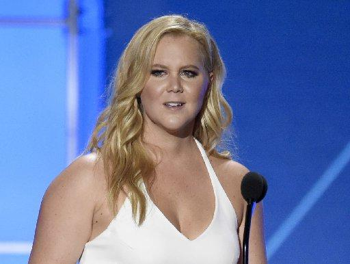 In this Jan. 17, 2016 file photo, Amy Schumer accepts the Critics' Choice MVP award at the 21st annual Critics' Choice Awards in Santa Monica, Calif.
