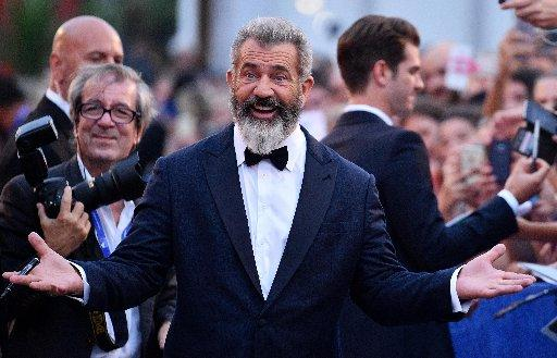 "Director Mel Gibson arrives on the red carpet for ""Hacksaw Ridge"" at the 73rd annual Venice International Film Festival, in Venice, Italy, Sunday, Sept. 4, 2016."